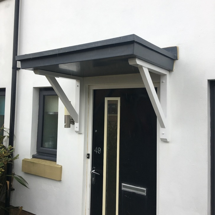Flat roof door canopy with our Straight brace gallows brackets for support